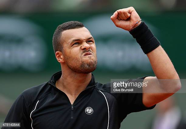 JoWilfried Tsonga of France celebrates a point in his Men's Singles match against Pablo Andujar of Spain on day six of the 2015 French Open at Roland...