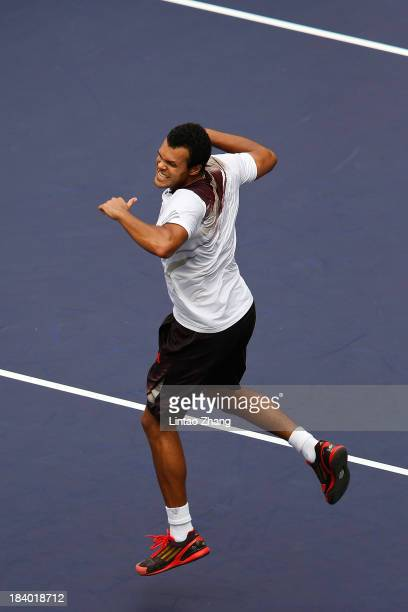Jo-Wilfried Tsonga of France celebrates after defeating Florian Mayer of Germany during day four of the Shanghai Rolex Masters at the Qi Zhong Tennis...