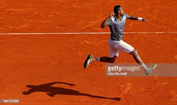 Jo-Wilfried Tsonga of France celebrates after his straight sets victory against Nikolay Davydenko of Russia in their second round match during day...