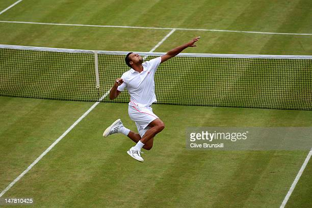 JoWilfried Tsonga of France celebrates after winning his Gentlemen's Singles fourth round match against Mardy Fish of the USA on day eight of the...