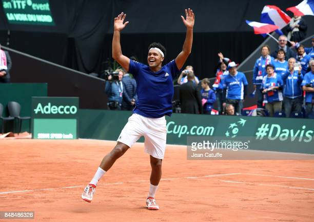 Jo-Wilfried Tsonga of France celebrates beating Dusan Lajovic of Serbia and winning the tie on day three of the Davis Cup World Group tie between...