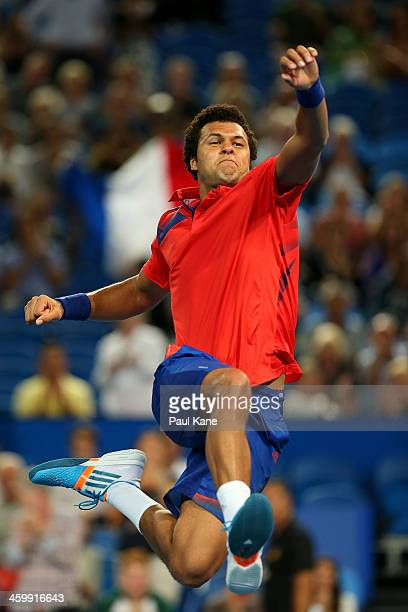 Jo-Wilfried Tsonga of France celebrates defeating John Isner of the United States in the men's singles match during day five of the Hopman Cup at...