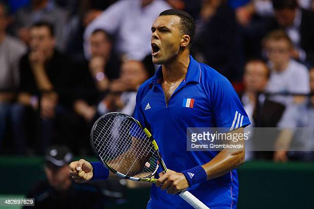 Jo-Wilfried Tsonga of France celebrates during his match against Peter Gojowzyk of Germany during day 1 of the Davis Cup Quarter Final match between...