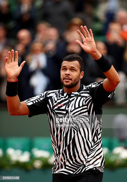 JoWilfried Tsonga of France celebrates following his victory during the Men's Singles first round match against JanLennard Struff of Germany on day...