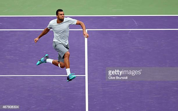 Jo-Wilfried Tsonga of France celebrates his three set victory against Tim Smyczek of the United States during the Miami Open Presented by Itau at...