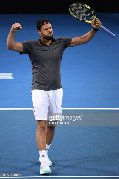 JoWilfried Tsonga of France celebrates his victory against Alex De Minaur of Australia during their men's singlesquarter final match at the Brisbane...
