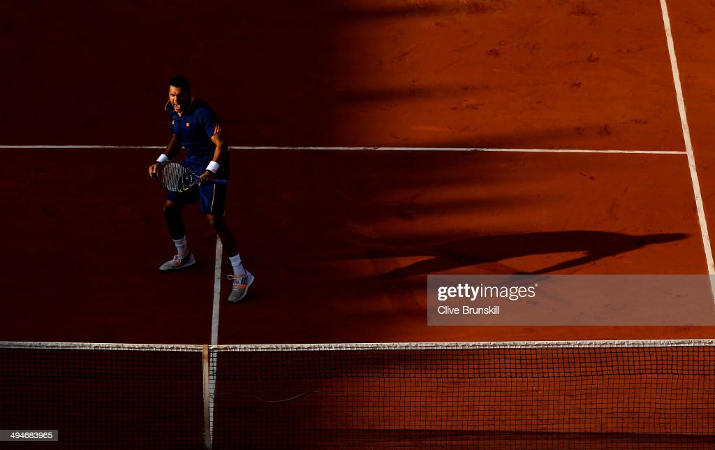 Jo-Wilfried Tsonga of France celebrates match point during his men's singles match against Jerzy Janowicz of Poland on day six of the French Open at Roland Garros on May 30, 2014 in Paris, France.