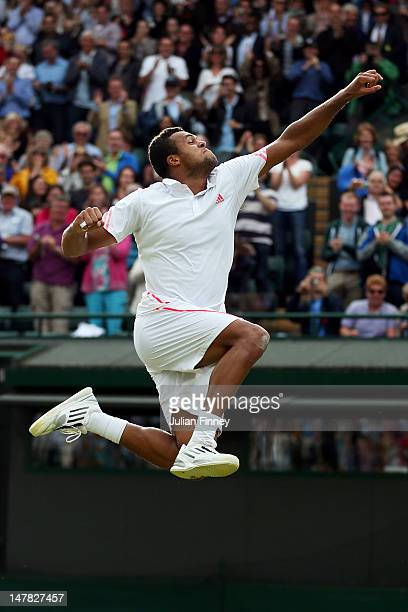 JoWilfried Tsonga of France celebrates match point during his Gentlemen's Singles quarter final match against Philipp Kohlschreiber of Germany on day...