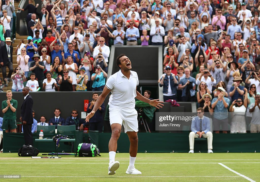Jo-Wilfried Tsonga of France celebrates victory during the Men's Singles third round match against John Isner of The United States on Middle Sunday of the Wimbledon Lawn Tennis Championships at the All England Lawn Tennis and Croquet Club on July 3, 2016 in London, England.