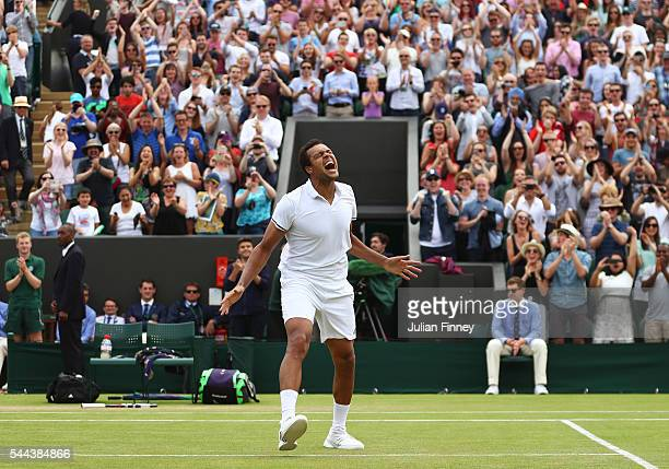 JoWilfried Tsonga of France celebrates victory during the Men's Singles third round match against John Isner of The United States on Middle Sunday of...