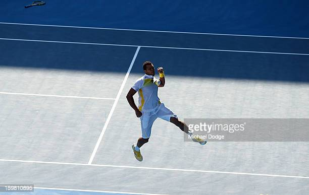 Jo-Wilfried Tsonga of France celebrates winning his fourth round match against Richard Gasquet of France during day eight of the 2013 Australian Open...