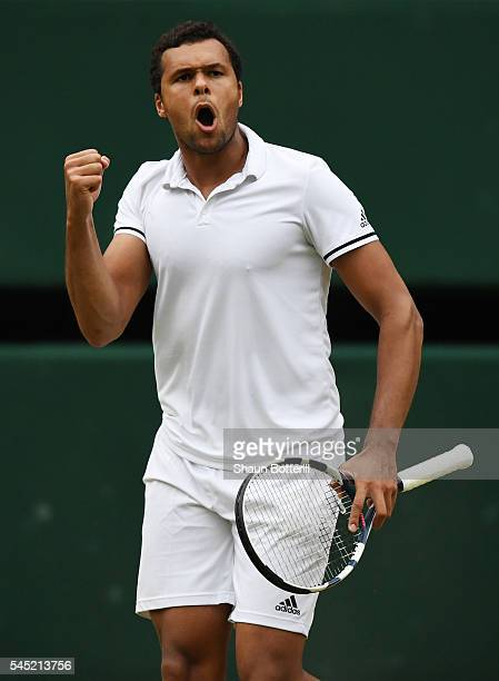 JoWilfried Tsonga of France celebrates winning his second set during the Men's Singles Quarter Finals match against Andy Murray of Great Britain on...