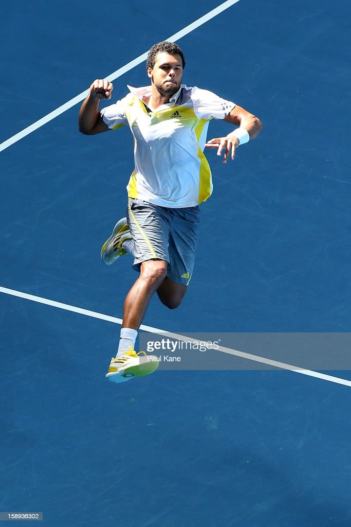 Jo-Wilfried Tsonga of France celebrates winning his singles match against Kevin Anderson of South Africa during day seven of the Hopman Cup at Perth Arena on January 4, 2013 in Perth, Australia.