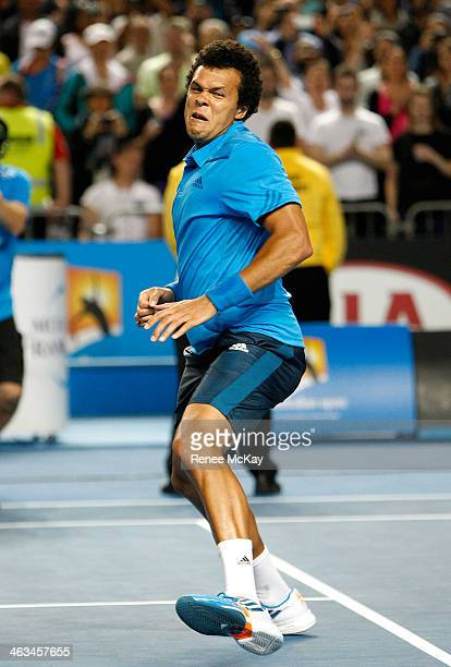 Jo-Wilfried Tsonga of France celebrates winning his third round match against Gilles Simon of France during day six of the 2014 Australian Open at...