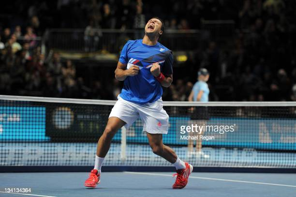Jo-Wilfried Tsonga of France celebrates winning the men's singles semi-final match against Tomas Berdych of Czech Republic during the Barclays ATP...