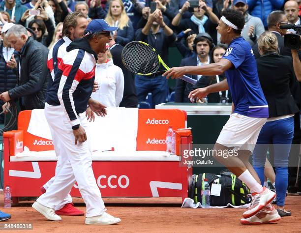 Jo-Wilfried Tsonga of France celebrates with Captain of France Yannick Noah beating Dusan Lajovic of Serbia and winning the tie on day three of the...