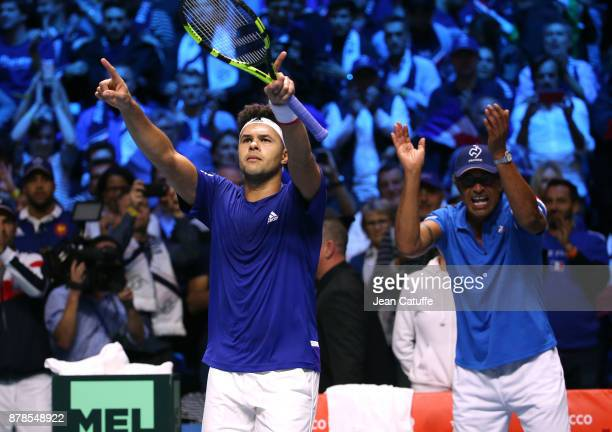 Jo-Wilfried Tsonga of France celebrates with his captain Yannick Noah his victory against Steve Darcis of Belgium during day 1 of the Davis Cup World...
