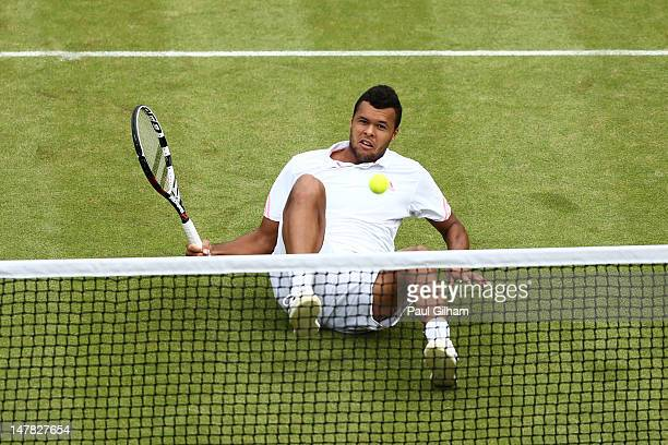 JoWilfried Tsonga of France eyes the ball during his Gentlemen's Singles quarter final match against Philipp Kohlschreiber of Germany on day nine of...