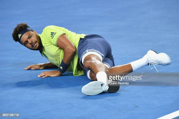 JoWilfried Tsonga of France falls over during his first round match against Kevin King of the United States on day one of the 2018 Australian Open at...