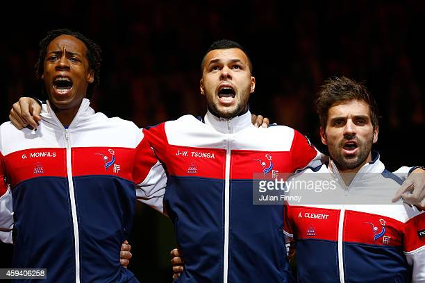 JoWilfried Tsonga of France Gael Monfils of France and Captain Arnaud Clement of France sing the national anthem during day two of the Davis Cup...