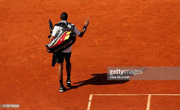 JoWilfried Tsonga of France gestures to the crowd as he leaves the court after defeat in his Men's Semi Final match against Stanislas Wawrinka of...