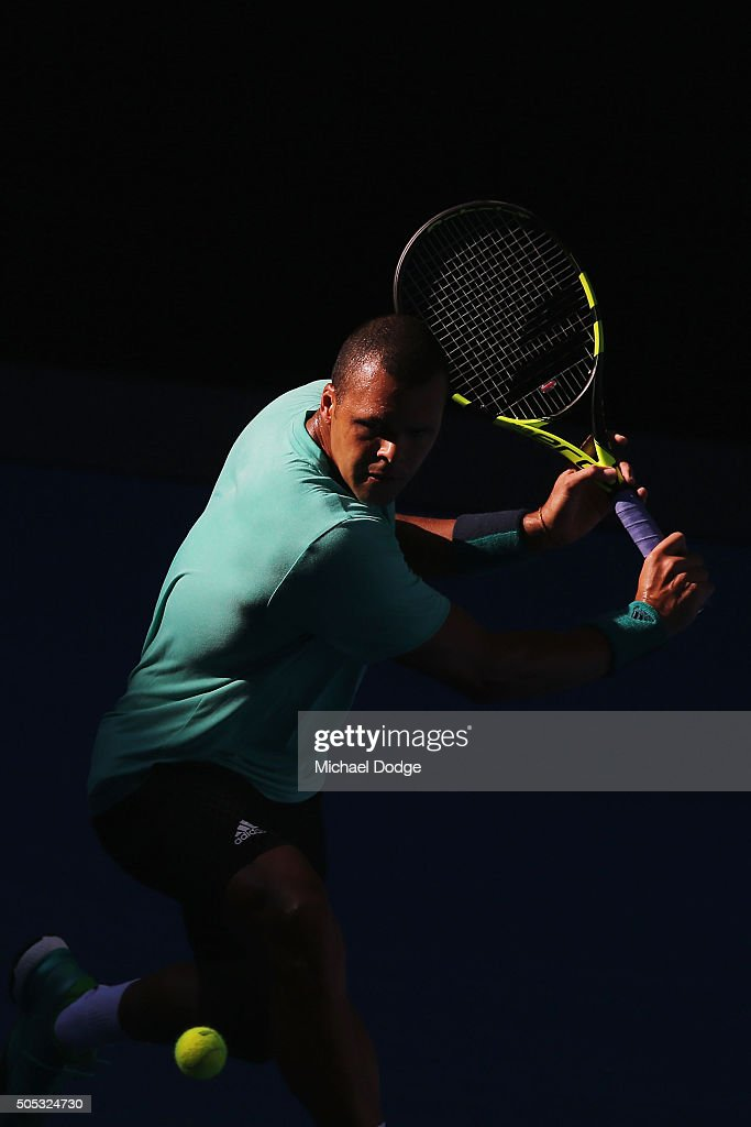 Jo-Wilfried Tsonga of France hits a backhand during a practice session ahead of the 2016 Australian Open at Melbourne Park on January 17, 2016 in Melbourne, Australia.