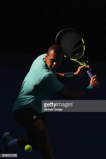 Jo-Wilfried Tsonga of France hits a backhand during a practice session ahead of the 2016 Australian Open at Melbourne Park on January 17, 2016 in...