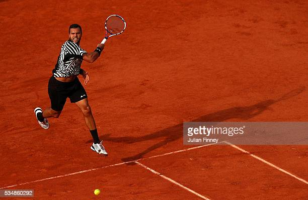 JoWilfried Tsonga of France hits a forehand during the Men's Singles third round match against Ernests Gulbis of Latvia on day seven of the 2016...