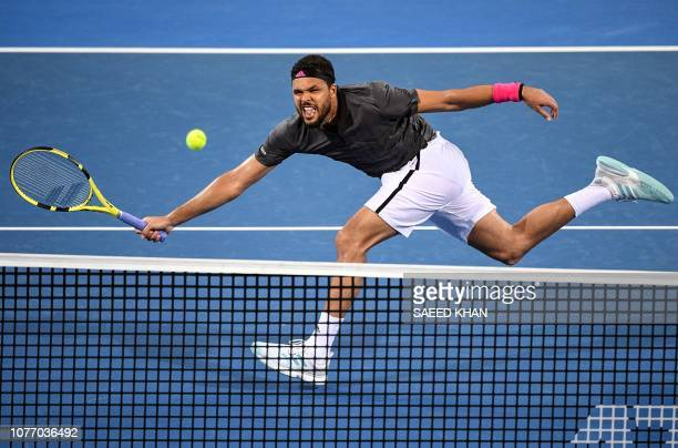 TOPSHOT JoWilfried Tsonga of France hits a return against Alex De Minaur of Australia during their men's singles quarter final match at the Brisbane...