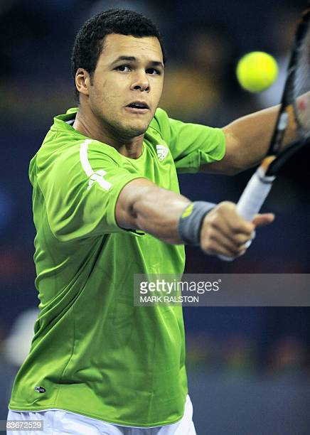 JoWilfried Tsonga of France hits a return against Novak Djokovic of Serbia in their men's singles match on the fifth day of the ATP Masters Cup...