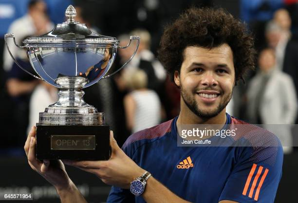 JoWilfried Tsonga of France holds the trophy after beating Lucas Pouille of France in the final of the Open 13 an ATP 250 tennis tournament at Palais...