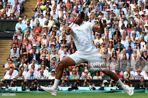 JoWilfried Tsonga of France in action against Andy Murray of Great Britain in the men's singles quarter finals on day nine of the 2016 Wimbledon...