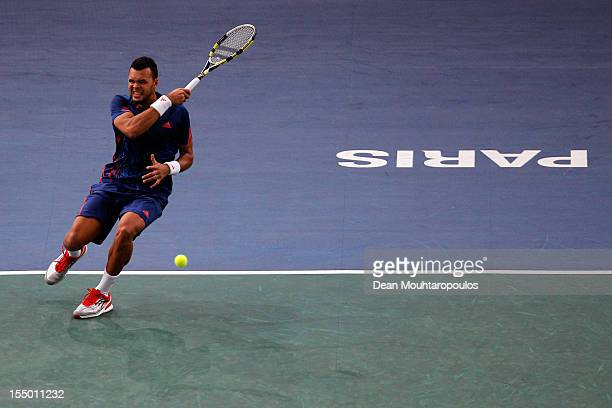 Jo-Wilfried Tsonga of France in action against Julien Benneteau of France during day 2 of the BNP Paribas Masters at Palais Omnisports de Bercy on...