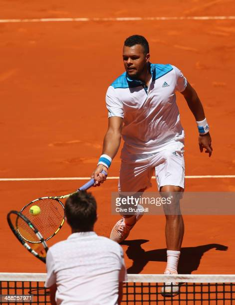 JoWilfried Tsonga of France in action at the net against Edouard RogerVasselin of France in their first round match during day three of the Mutua...
