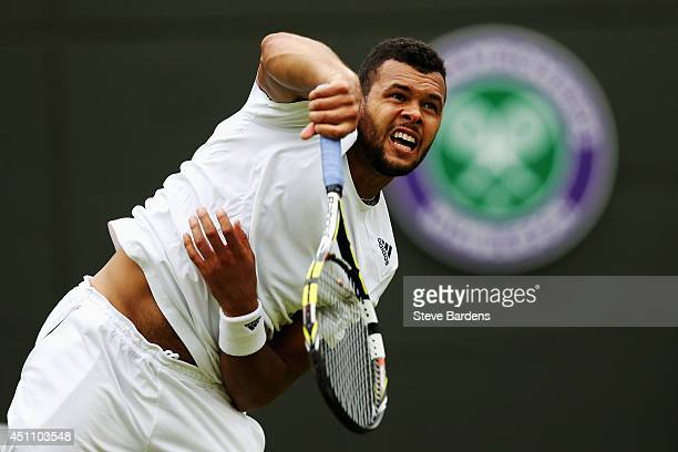 Jo-Wilfried Tsonga of France in action during his Gentlemen's Singles first round match against Jurgen Melzer of Austria on day one of the Wimbledon...