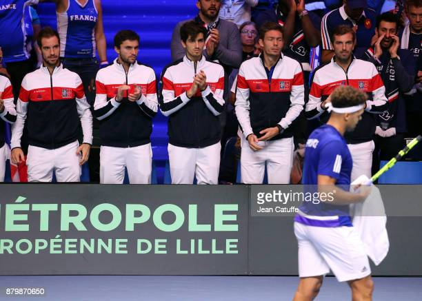 JoWilfried Tsonga of France is cheered by teammates Richard Gasquet Gilles Simon PierreHughes Herbert Nicolas Mahut Julien Benneteau during day 3 of...