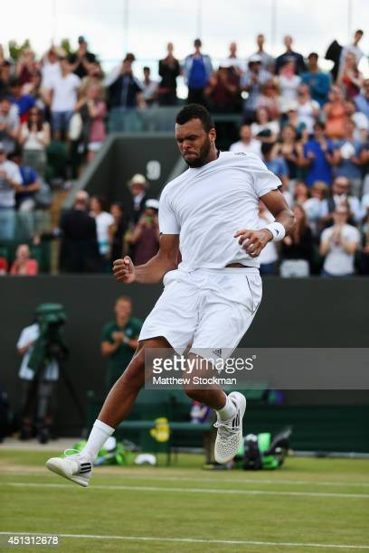 JoWilfried Tsonga of France jumps in the air in celebrates after winning his Gentlemen's Singles third round match against Jimmy Wang of Chinese...
