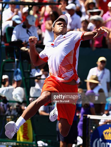 JoWilfried Tsonga of France leaps into the air to celebrate his straight sets victory against Xavier Malisse of Belgium during their second round...