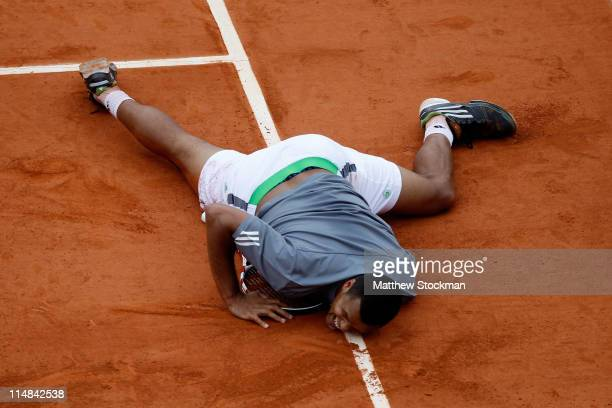 JoWilfried Tsonga of France lies on the clay after slipping during the men's singles round three match between Stanislas Wawrinka of Switzerland and...