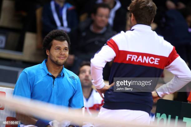 JoWilfried Tsonga of France listens to Arnaud Clement captain of France during the 1st round Davis Cup tie between France and Australia at the...