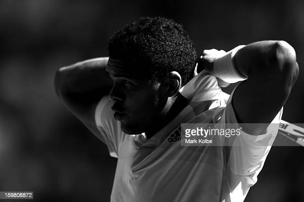 Jo-Wilfried Tsonga of France looks on in his fourth round match against Richard Gasquet of France during day eight of the 2013 Australian Open at...