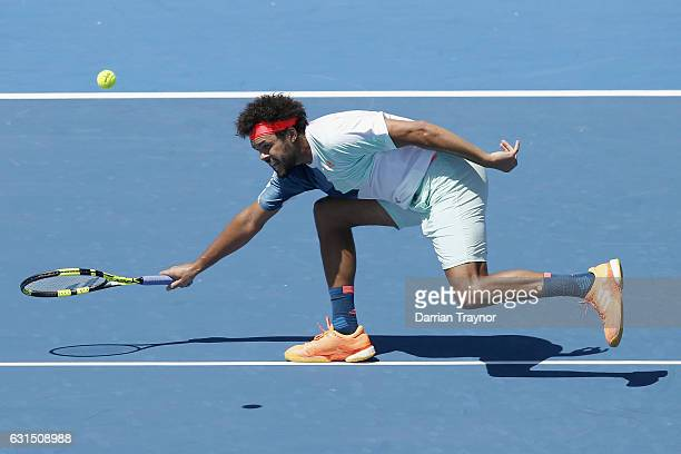 Jo-Wilfried Tsonga of France lunges to play a forehand shot in his match against Borna Coric of Croatia during day three of the 2017 Priceline...