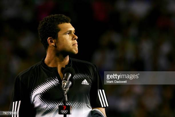 Jo-Wilfried Tsonga of France makes a speech after losing the men's final match against Novak Djokovic of Serbia on day fourteen of the Australian...