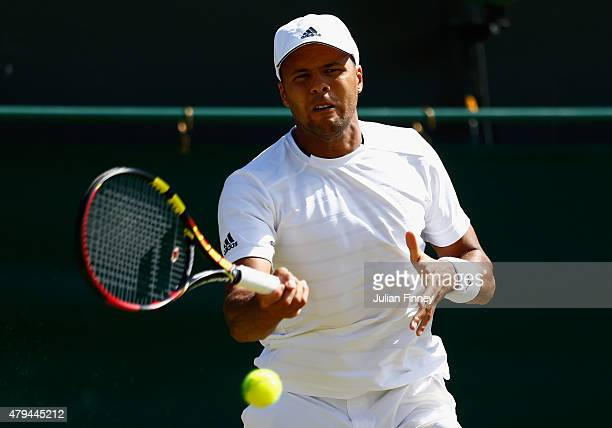 JoWilfried Tsonga of France plays a back hand in his Mens Singles Third Round match against Ivo Karlovic of Croatia during day six of the Wimbledon...
