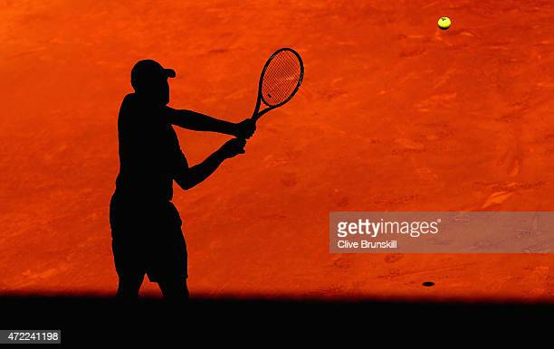 Jo-Wilfried Tsonga of France plays a backhand against Lukas Rosol of the Czech Republic in their second round match during day four of the Mutua...