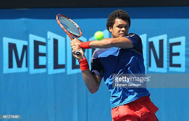 JoWilfried Tsonga of France plays a backhand during a practice session ahead of the 2014 Australian Open at Melbourne Park on January 8 2014 in...