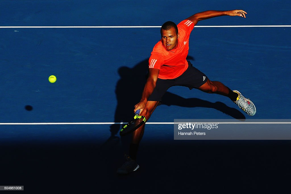 Jo-Wilfried Tsonga of France plays a backhand during his second round singles match against Fabio Fognini of Italy during the 2016 ASB Classic at the ASB Tennis Arena on January 14, 2016 in Auckland, New Zealand.