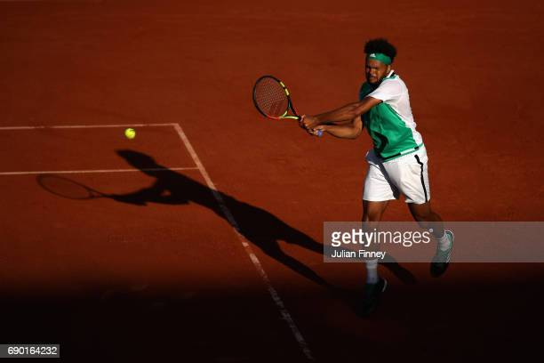 JoWilfried Tsonga of France plays a backhand during the mens singles first round match against Renzo Olivio of Argentina on day three of the 2017...