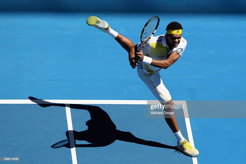 Jo-Wilfried Tsonga of France plays a backhand in his first round match against Michael Llodra of France during day two of the 2013 Australian Open at Melbourne Park on January 15, 2013 in Melbourne, Australia.