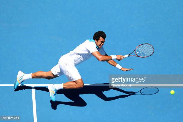 Jo-Wilfried Tsonga of France plays a backhand in his first round match against Filippo Volandri of Italy during day two of the 2014 Australian Open...